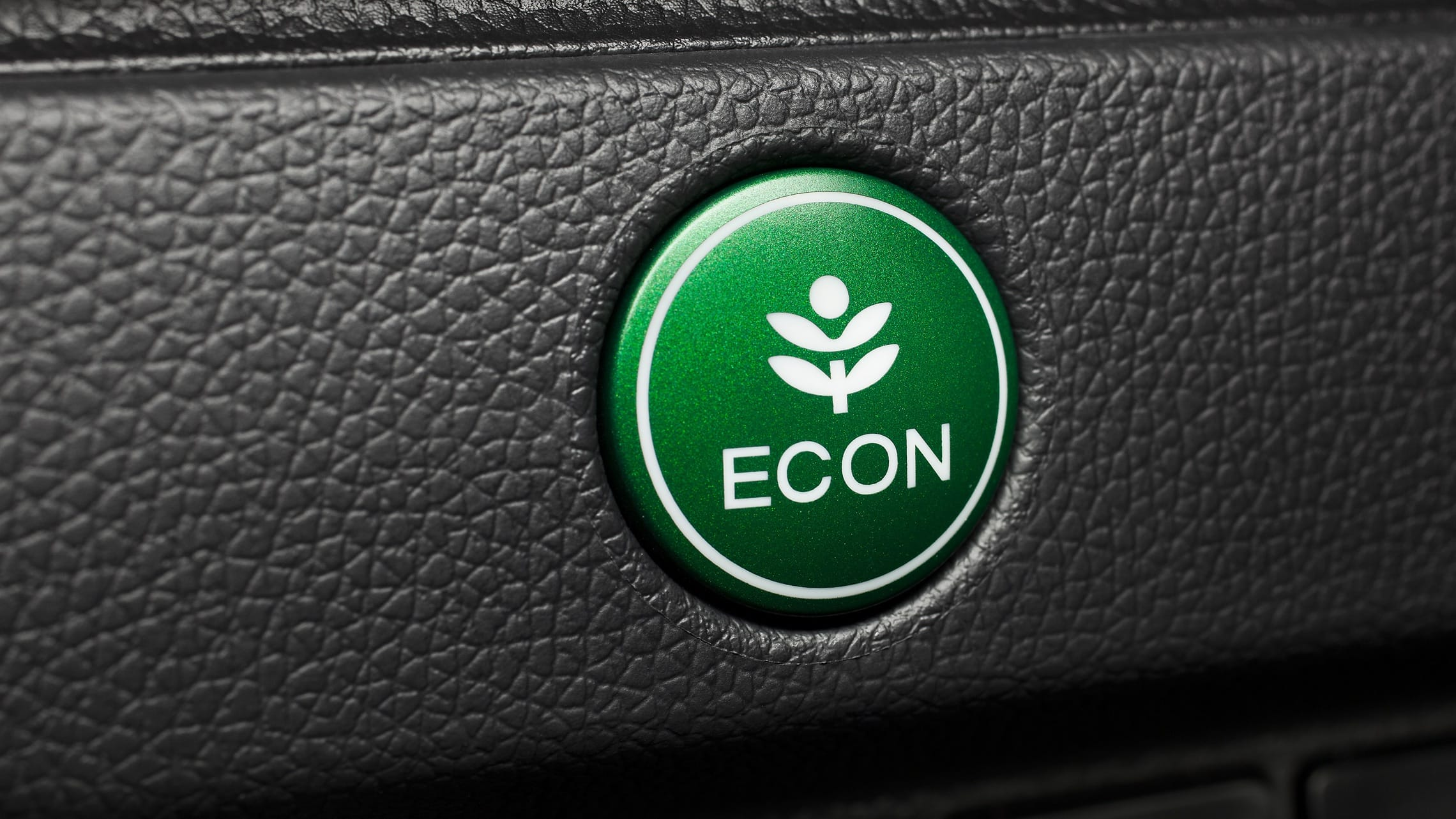 Green ECON button detail on 2020 Honda Fit EX-L.