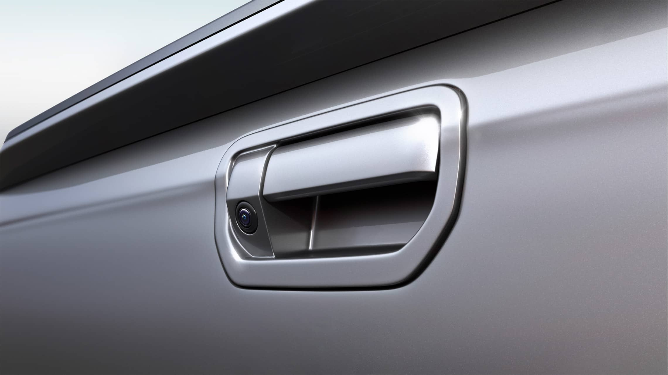 Multi-angle rearview camera detail displayed on tailgate handle on the 2020 Honda Ridgeline in Lunar Silver Metallic.