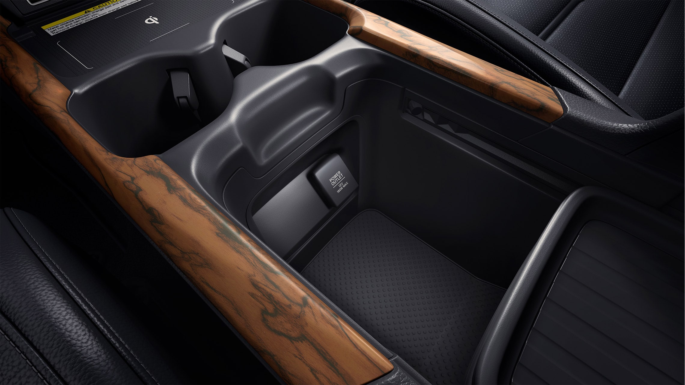 Customizable center console storage detail in the 2021 Honda CR-V with Gray Leather interior.