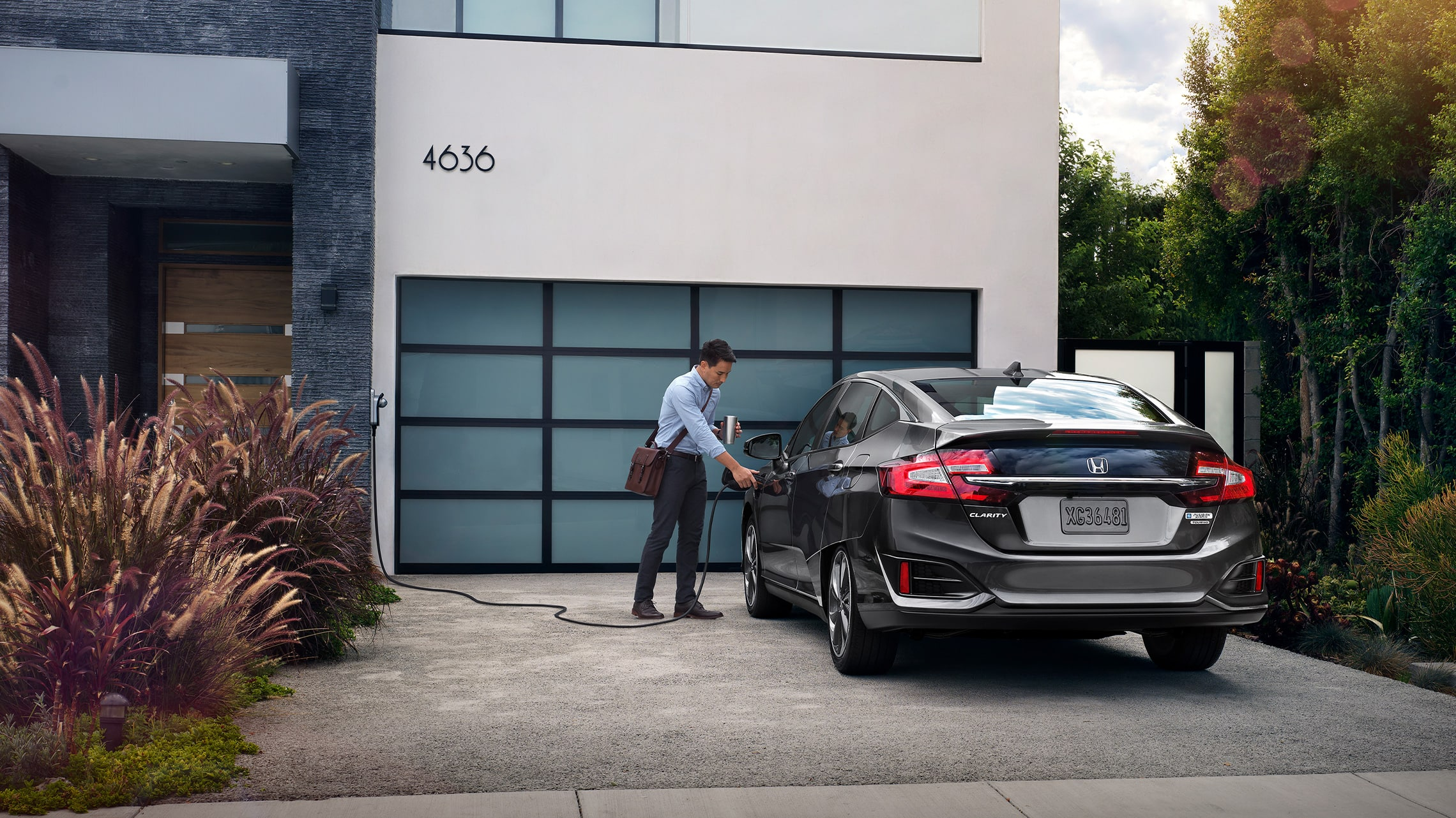 2021 Clarity Plug-In Hybrid being charged outside residence.