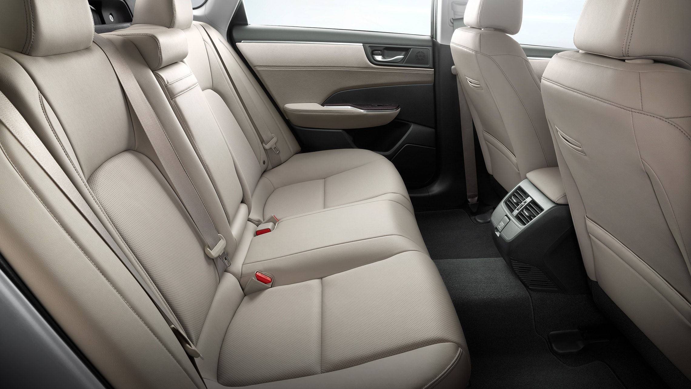 Rear seats of 2021 Clarity Plug-In Hybrid with Beige Leather-trimmed interior.